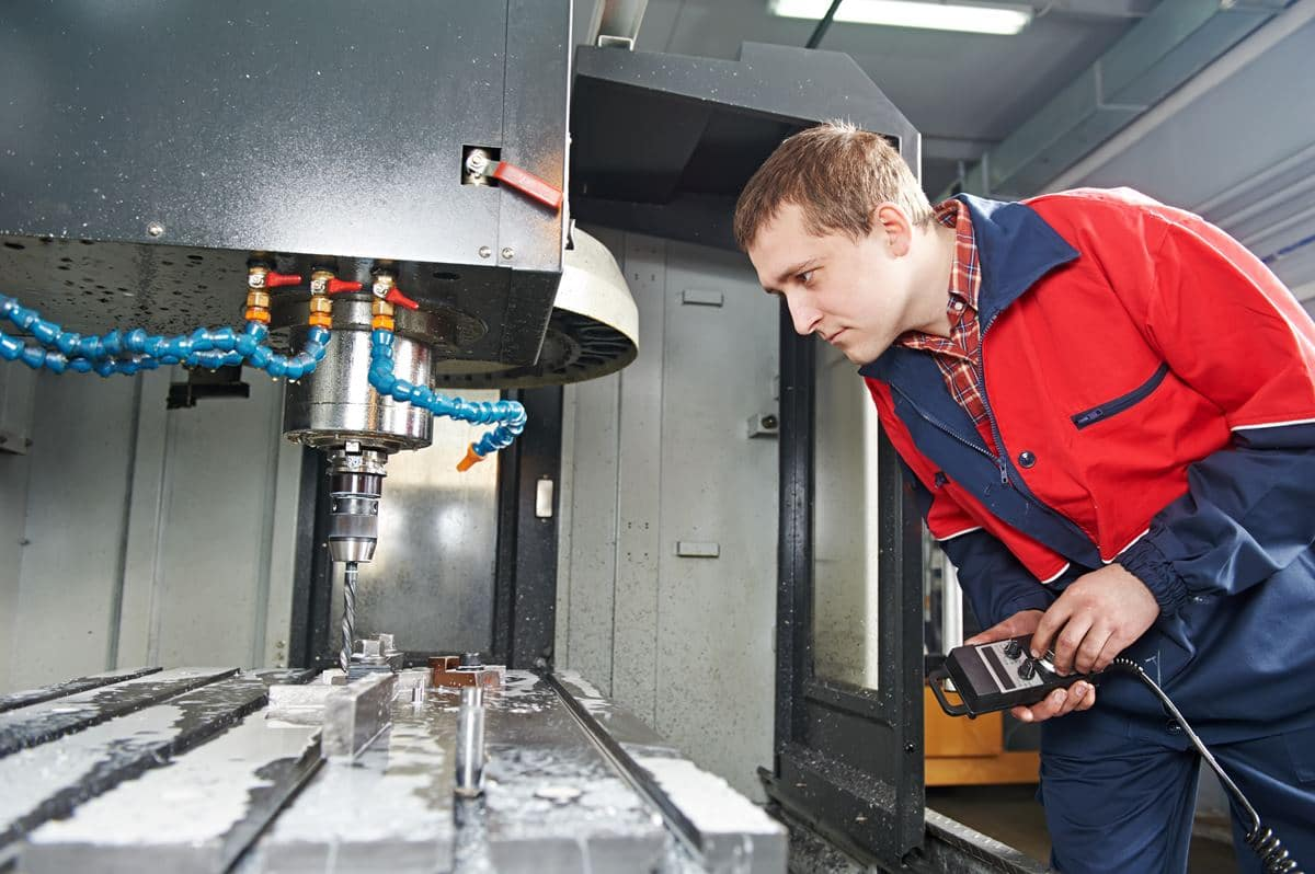 mechanical technician worker of cnc milling cutting machine center at tool workshop manufacturing